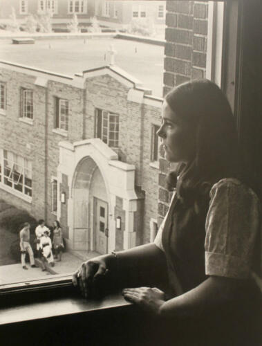 Student in Medaille window